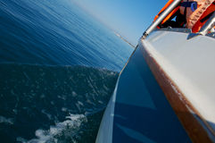 Water wake behind yacht Stock Images