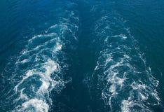 Water wake turbulence. Water wake swirls background from ferry boat Stock Photo