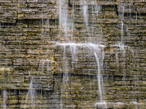 Water and wall. Abstract background : Waterfall and brick walls Royalty Free Stock Photo