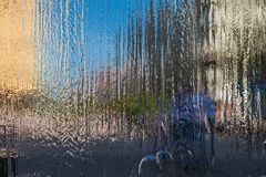 Water wall of the fountain on the background of the cityscape. Ivanofrankivsk Stock Photo