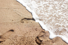 Water washes footprints1 Stock Images