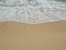 Water Washes Over the Sand royalty free stock photo
