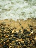 Rocky Shore of Lake Michigan. Water washing onto the rocky shore of Lake Michigan on a cloudy day Stock Images