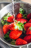Water Washing over Strawberries Stock Photos