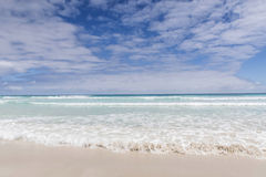 Water Washing Up On The White Sand with A View Of An Island; Gal Royalty Free Stock Photos