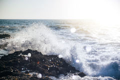 Water Wave Bump on Black Beach Rock Stock Photos