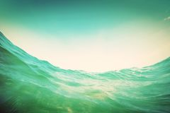 Water wave in the ocean. Underwater and blue sky. Vintage Royalty Free Stock Photo