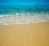 Water wave and sand Stock Image