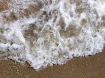 Water wave at the seashore. With foam Stock Photography