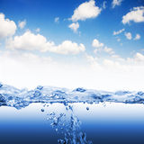 Water wave with splashes and bubbles Royalty Free Stock Photos