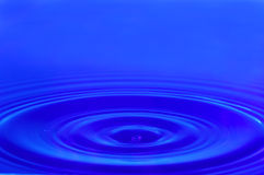 Water waves. Blue water waves and water drop Royalty Free Stock Image