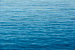 Water waves. Blue abstract water surface with small waves Stock Images