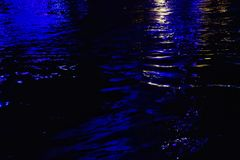 Blurred colorful light reflection on river surface stock image