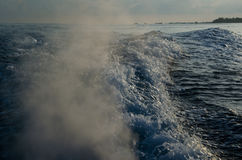 Water waves made by boat Stock Images