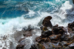 Water, waves and rocks Stock Photos