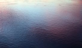 Water background by sunset. Stock Image