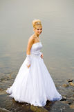 Water wedding. Closeup portrait of bride dressed in wedding gown in water Stock Photos