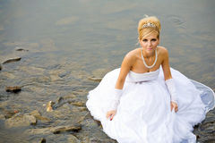 Water wedding. Closeup portrait of bride dressed in wedding gown in water Royalty Free Stock Photo