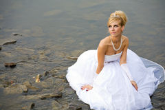 Water wedding. Closeup of bride dressed in wedding gown in water Royalty Free Stock Images