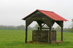 Water well. In a meadow set against a dark sky Royalty Free Stock Photo