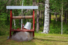 Water well with a bucket Stock Image