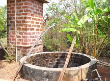 A Water Well - Dug Well - in an Indian Village. This is a photograph of a water well - a dug well - made of bricks, captured in an Indian village stock images