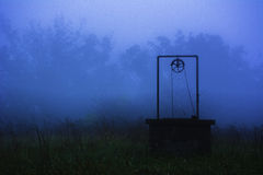 Water Well In Fog Royalty Free Stock Photo
