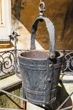 A water well with an old bucket Stock Photos