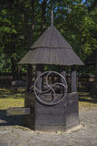 Water well. An old water well with a cable winch royalty free stock photo