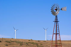 Water well and wind turbines Stock Photos