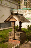 Water well. Wooden water well in the street Stock Photos