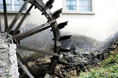 Water wheel. A water wheel in front of a house in swiss Royalty Free Stock Photos