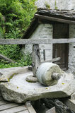 Water Wheel. Water flows over wheel of old wood and stone mill Royalty Free Stock Image