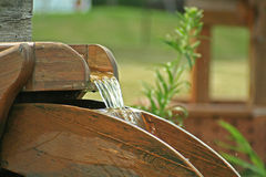 Water Wheel. A water wheel water feature Stock Photos