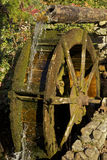Water Wheel. Old Water Wheel with flowing water Stock Photos