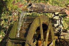 Water Wheel. Old Water Wheel with flowing water Stock Images