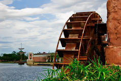 Water wheel. A view of a large water wheel on the side of a lake or river Royalty Free Stock Photography