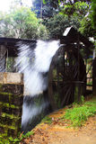 Water Wheel. In action, used to keep the sugar cane mash machine running Stock Photography