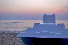 Water wheel on the beach Stock Photo