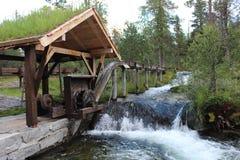 Water-wheel in board sawmill. Royalty Free Stock Image