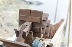 Water wheel for catch fish vintage focus on front blur background. In fish farm Stock Images
