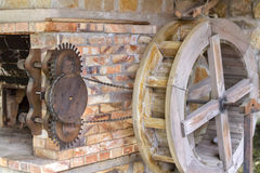 Water wheel with chain and gears Stock Photos