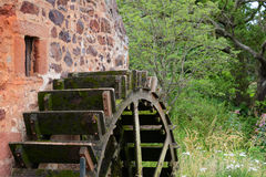 Water wheel close up, Preston Mill, East Lothian. This old water wheel is part of Preston Mill, near East Linton, East Lothian, Scotland, UK, and dates from the Royalty Free Stock Photo