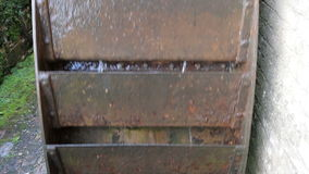 Water Wheel in close up. Renovated water mill used to turn a mill stone stock video footage