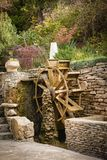 Water wheel. Decorative wooden water wheel in the park Stock Photo
