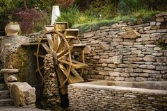 Water wheel. Decorative wooden water wheel in the park Royalty Free Stock Photography