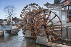 Water wheel in front of old town in China Stock Image