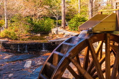 Water wheel of Grist Mill in Stone Mountain Park, USA. A stream of water falling on the water wheel of the Grist Mill in the Stone Mountain Park, Georgia, USA Royalty Free Stock Photo