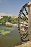 Water-wheel, Hama, Syria. A noria is a machine for lifting water into a small aqueduct, either for the purpose of irrigation or, in at least one known instance Royalty Free Stock Photos