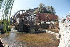 Water wheel ,landmark of Lijiang Dayan old town. Royalty Free Stock Photography